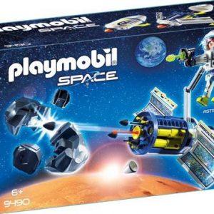 Spationaute avec satellite et météorite
